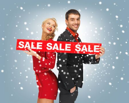 bright picture of man and woman with sale sign Stock Photo - 16549384