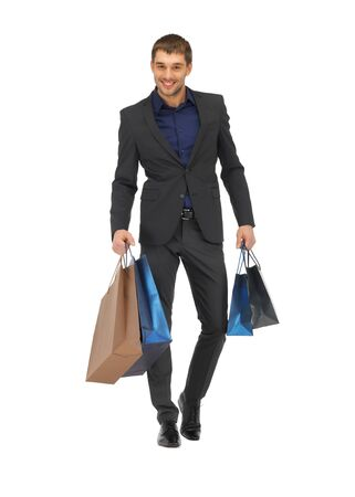 fashion bag: picture of handsome man in suit with shopping bags