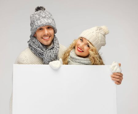 picture of family couple in a winter clothes holding blank board Stock Photo - 16619256