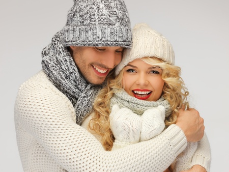 bright picture of family couple in a winter clothes Stock Photo - 16619318
