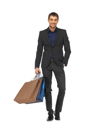 picture of handsome man in suit with shopping bags  Stock Photo - 16584625
