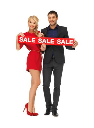 bright picture of man and woman with sale sign Stock Photo - 16584779