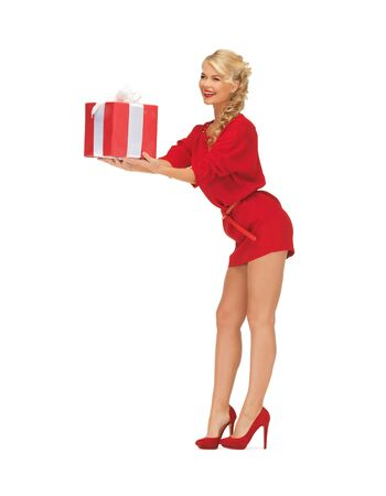 bright picture of woman in red dress with present Stock Photo - 16584713
