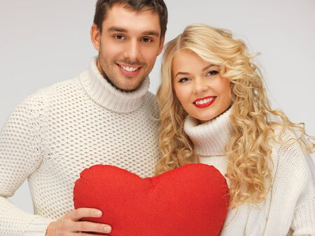lovely couple: picture of family couple in a sweaters with heart Stock Photo