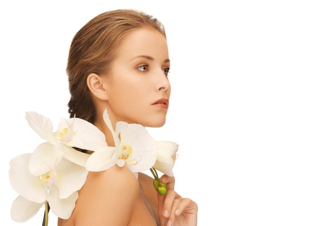 bright picture of lovely woman with orchid flower  Stock Photo - 16585304
