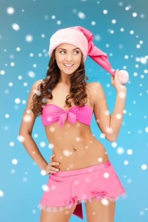 picture of cheerful santa helper girl in lingerie with snow photo