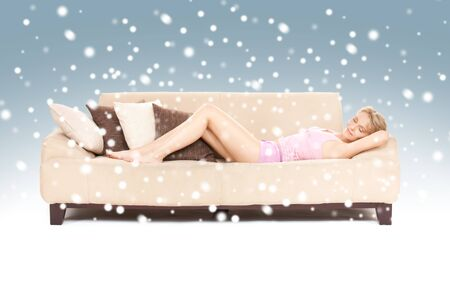 bright picture of sleeping woman on sofa with snow photo