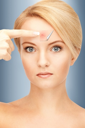 beauty spot: picture of beautiful woman pointing to forehead