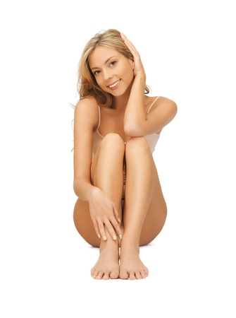 bodycare: picture of beautiful woman in cotton undrewear touching her legs Stock Photo