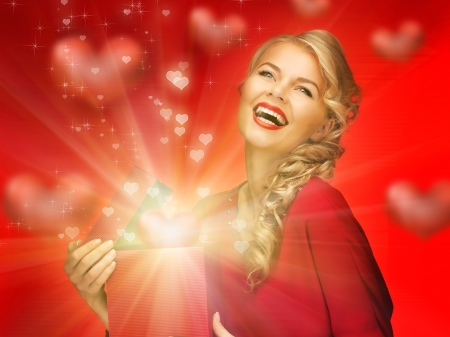 picture of lovely woman in red dress with valentine gift box Stock Photo - 16671651
