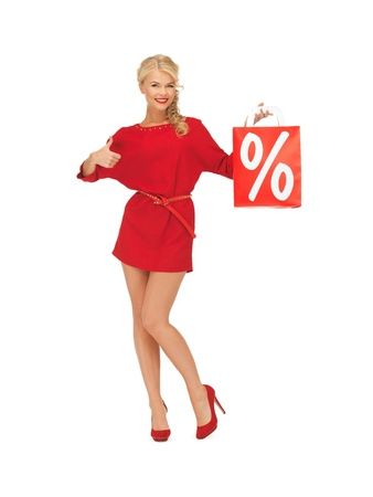 picture of woman in red dress with shopping bag showing thumbs up photo