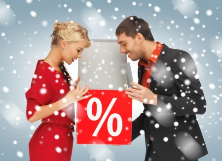 sign: bright picture of man and woman with percent sign