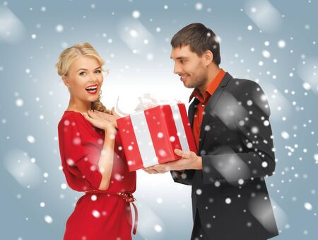 formal wear clothing: picture of man and woman with present Stock Photo