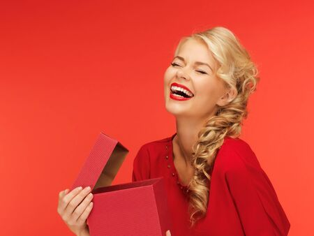 picture of lovely woman in red dress with opened gift box photo