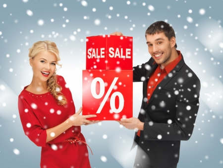 bright picture of man and woman with percent sign photo