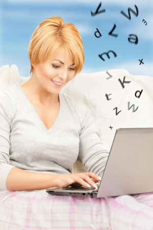 remote access: bright picture of happy woman with laptop computer  Stock Photo
