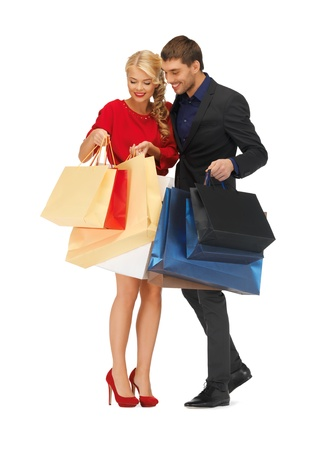 shopaholics: bright picture of man and woman with shopping bags