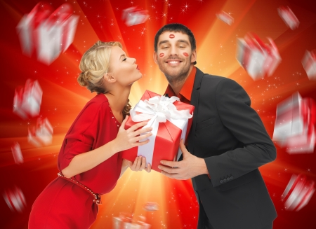 lipstick kiss: picture of man and woman with present Stock Photo