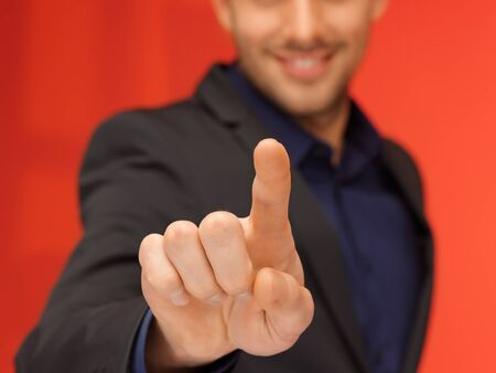bright picture of handsome man in suit pressing virtual button  Stock Photo - 16693884
