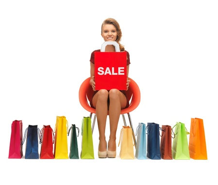 picture of teenage girl in red dress with shopping bags Stock Photo - 16693840