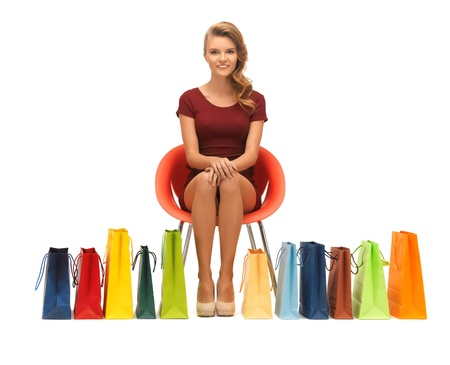 picture of teenage girl in red dress with shopping bags Stock Photo - 16693842