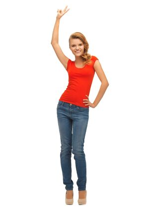 picture of teenage girl in red t-shirt showing victory sign Stock Photo - 16693809