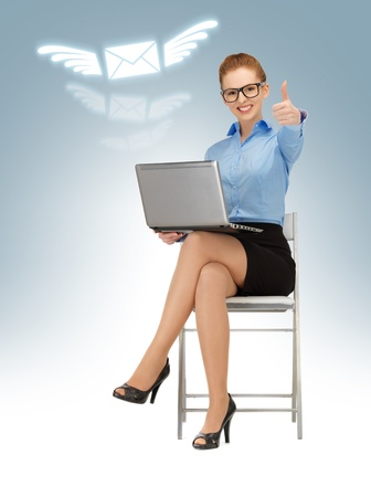 business woman with laptop showing thumbs up photo