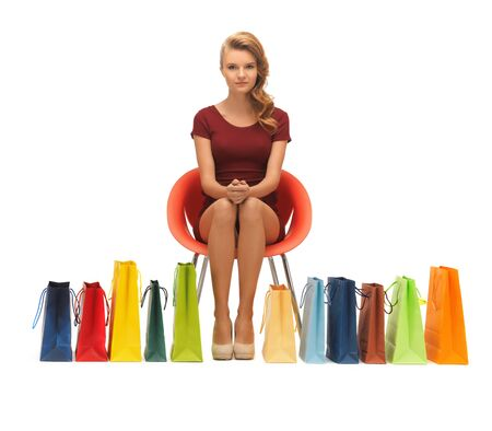 picture of teenage girl in red dress with shopping bags Stock Photo - 16714348