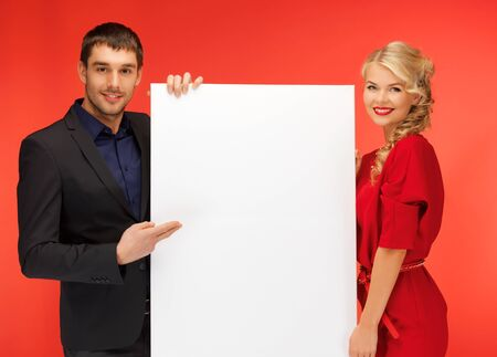 bright picture of couple holding big blank board Stock Photo - 16716566