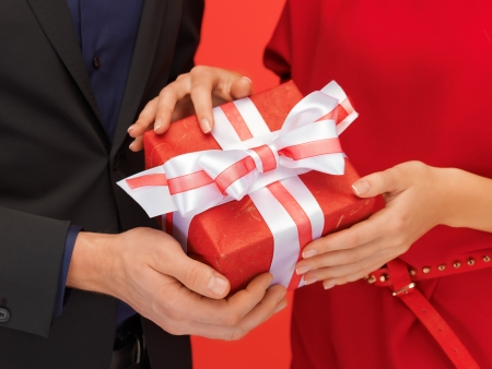 closeup picture of man and woman s hands with gift box Stock Photo - 16716540