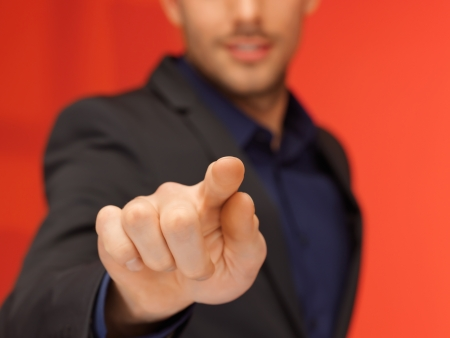 bright picture of handsome man in suit pressing virtual button Stock Photo - 16716544