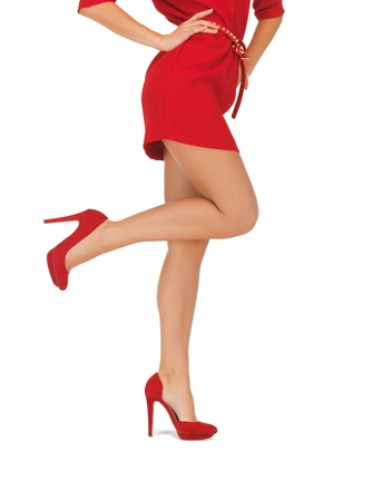 fitted: closeup picture of woman in red dress on high heels Stock Photo