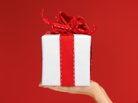 closeup picture of woman s hands holding a gift box photo