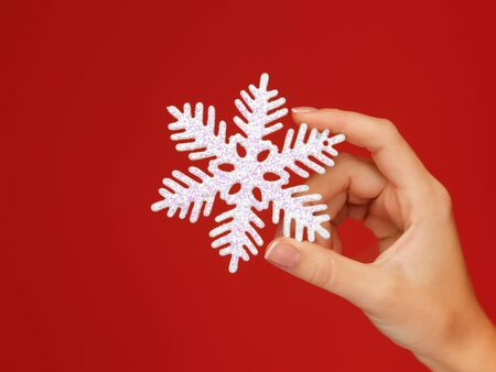 closeup picture of woman s hands holding a snowflake Stock Photo - 16716528