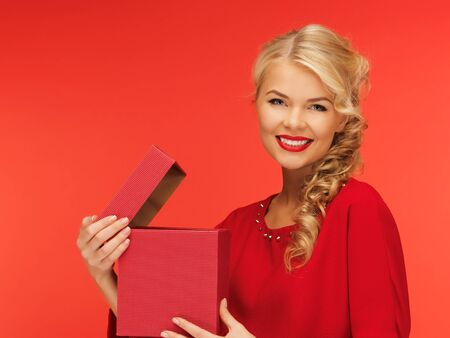picture of lovely woman in red dress with opened gift box Stock Photo - 16716527