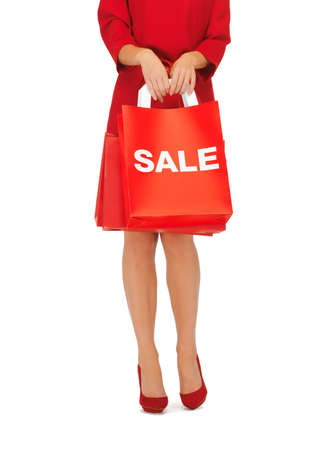 closeup picture of woman on high heels holding shopping bags Stock Photo - 16716568