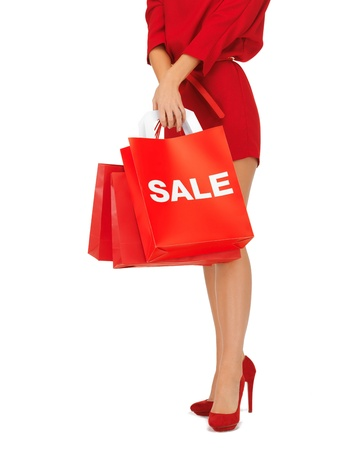 closeup picture of woman on high heels holding shopping bags Stock Photo - 16716569