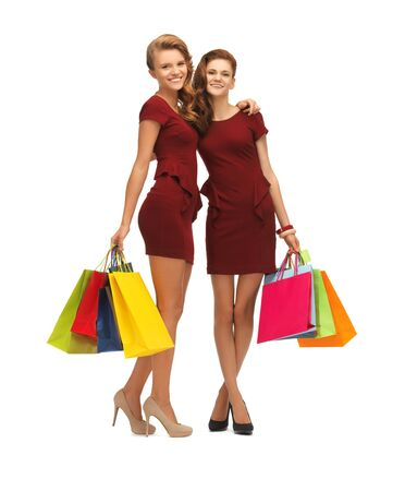 picture of two teenage girls in red dresses with shopping bags Stock Photo - 16716551