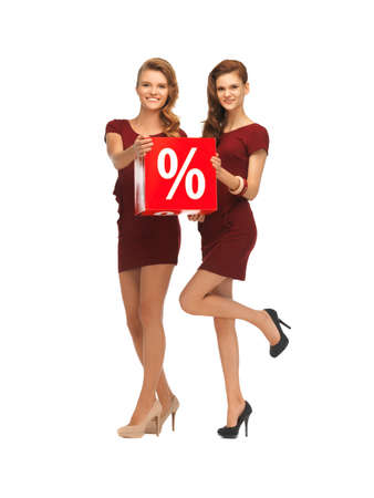 picture of two teenage girls in red dresses with percent sign Stock Photo - 16716589
