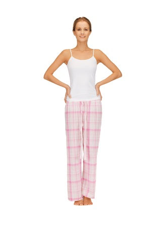 bright picture of happy and smiling woman in cotton pajamas Stock Photo - 16716590