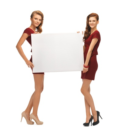 picture of two teenage girls in red dresses with blank board Stock Photo - 16716565