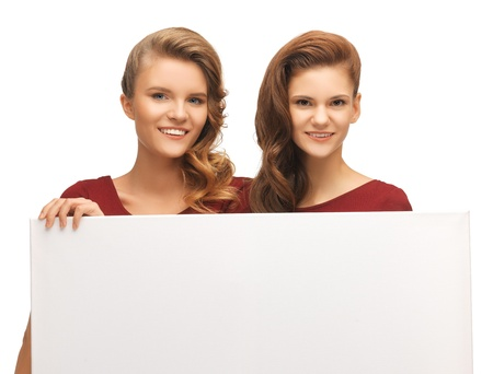 picture of two teenage girls in red dresses with blank board Stock Photo - 16716542