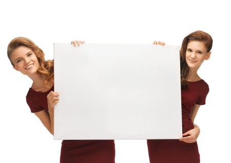 picture of two teenage girls in red dresses with blank board Stock Photo - 16716554