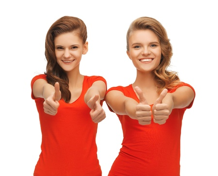 picture of two teenage girls in red t-shirts showing thumbs up Stock Photo - 16716538
