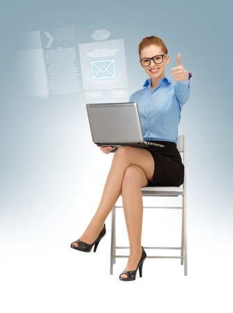 business woman with laptop showing thumbs up Stock Photo - 16716571