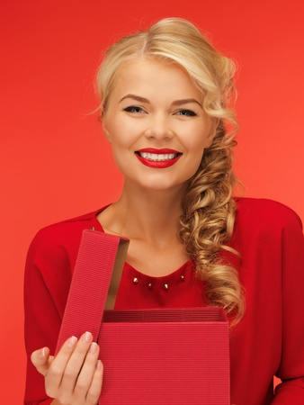 fancy box: picture of lovely woman in red dress with opened gift box Stock Photo