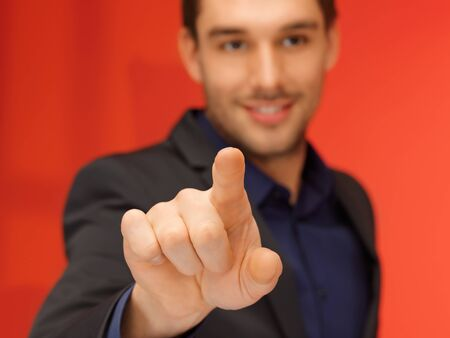 bright picture of handsome man in suit pressing virtual button Stock Photo - 16734262