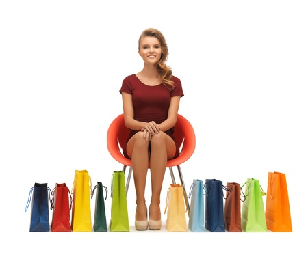 picture of teenage girl in red dress with shopping bags Stock Photo - 16734244