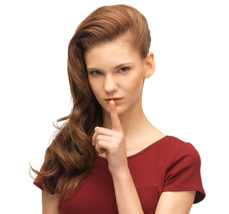 picture of lovely teenage girl in red dress with finger on lips Stock Photo - 16734251