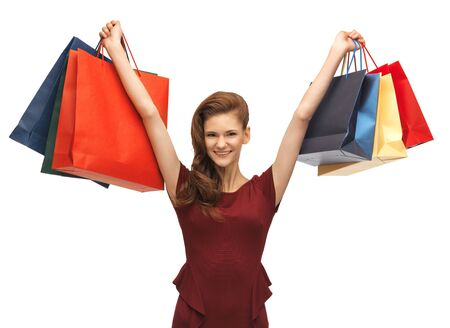 picture of teenage girl in red dress with shopping bags Stock Photo - 16734257